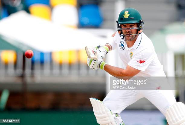 South African batsman Dean Elgar plays a shot during the second day of the first Test cricket match between South Africa and Bangladesh in...