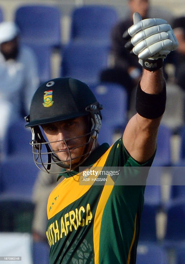 South African batsman Faf du Plessis celebrates after making fifty runs during the third day-night international in Sheikh Zayed Cricket Stadium in Abu Dhabi on Novemver 6, 2013. South African captain AB de Villiers won the toss and decided to bat in the first. The five-match series is tied at 1-1. AFP PHOTO/ Asif HASSAN