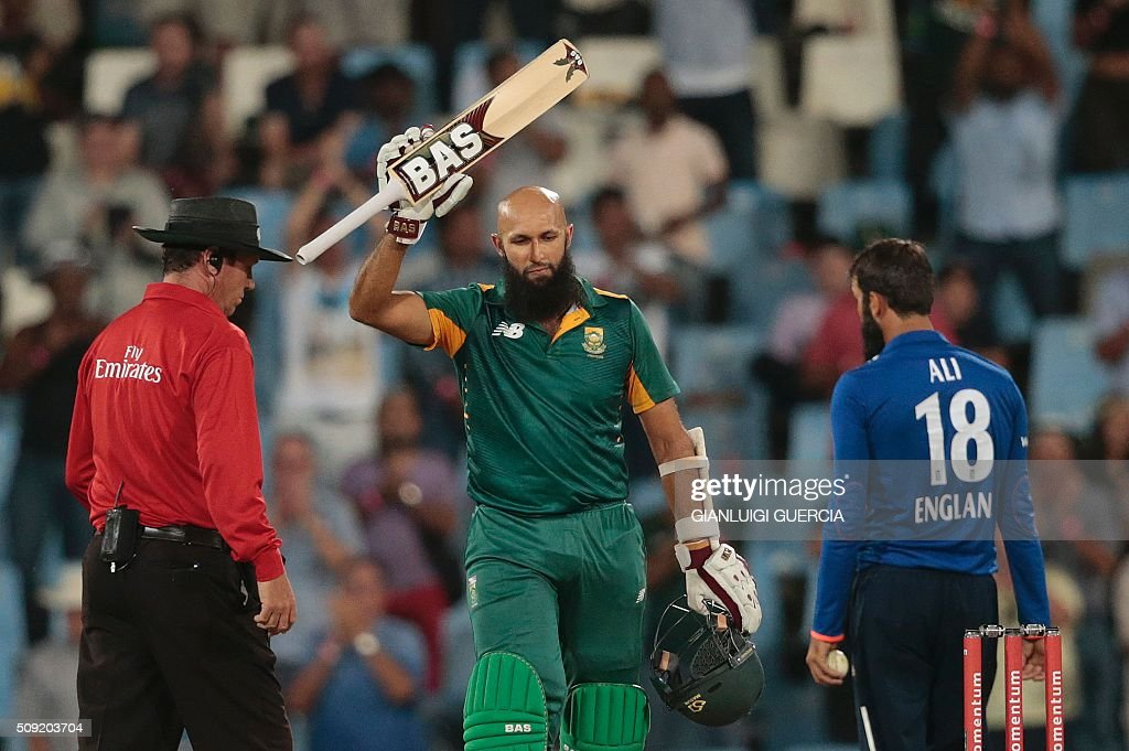 South African batsman Hashim Amla (C) celebrates after scoring a century (100 runs) during the third One Day International (ODI) cricket match between England and South Africa at Supersport park on February 9, 2016 in Centurion, South Africa. GUERCIA