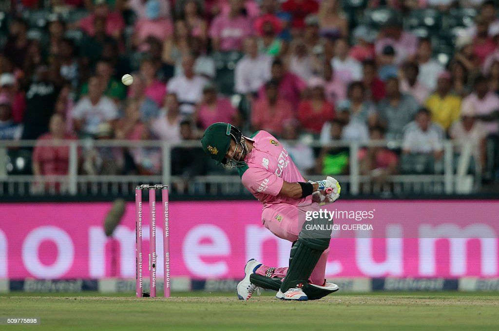 South African batsman JP Duminy ducks a ball delivery during the fourth One Day International match between England and South Africa at Wanderers on February 12, 2016 in Johannesburg. South African player are dressed in pink to raise awareness for breast cancer. / AFP / GIANLUIGI GUERCIA