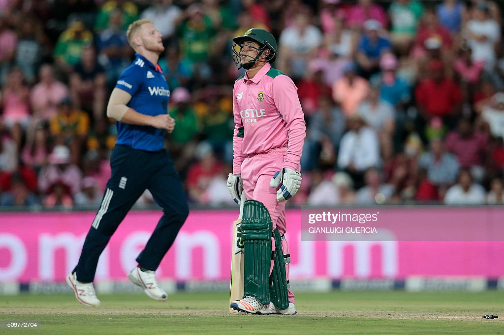 South African batsman Quinton de Kock (R) is bowled by England's bowler Ben Stokes (L) during the fourth One Day International match between England and South Africa at Wanderers on February 12, 2016 in Johannesburg. South African player are dressed in pink to raise awareness for breast cancer. / AFP / GIANLUIGI GUERCIA