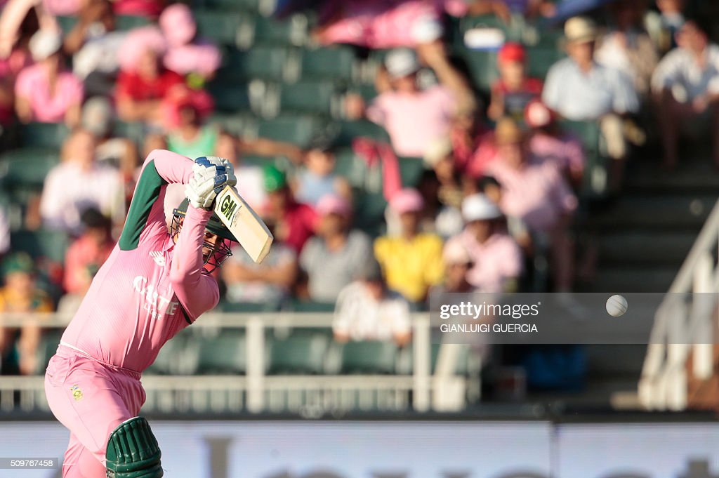 South African batsman Quinton de Kock plays a shot during the fourth One Day International (ODI) match between England and South Africa at Wanderers on February 12, 2016 in Johannesburg, South Africa. South African player are dressed in pink to raise awareness about breast cancer. / AFP / GIANLUIGI GUERCIA
