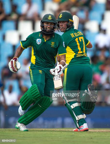 South African batsmen AB de Villiers and Hashim Amla scramble a run during the fifth and last One Day International cricket match between South...