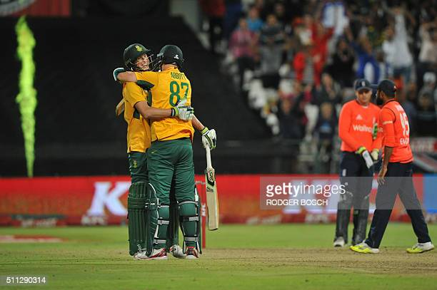 South African batsmen Chris Morris and Kyle Abbott celebrate after Morris hit the winning shot during the first of two T20 matches helping South...