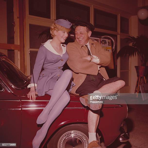 South African born actor Sid James pictured with actress Christine Rodgers on the set of the film 'Carry On Cabby' at Pinewood Studios in 1963