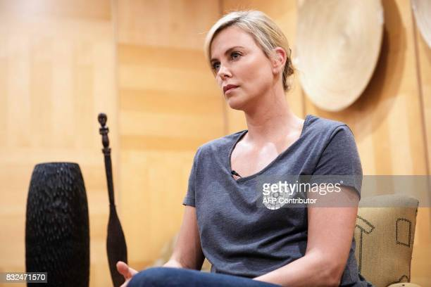 South African born actress and Academy Award winner Charlize Theron gives an interview to Agence FrancePresse at her hotel on August 16 2107 in...