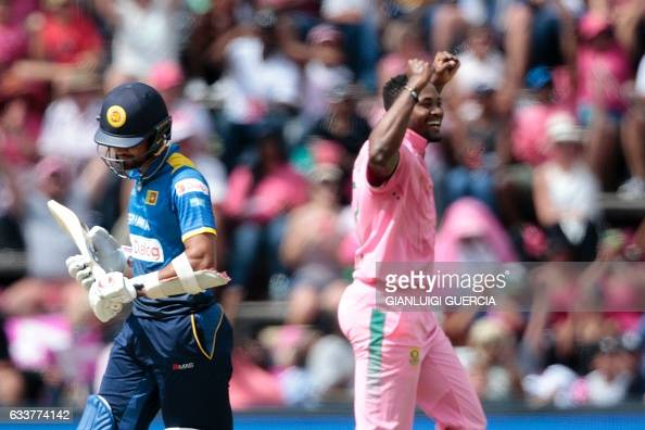 South African bowler Andile Phehlukwayo celebrates the dismissal of Sri Lanka batsman Dinesh Chandimal during the third One Day International match...