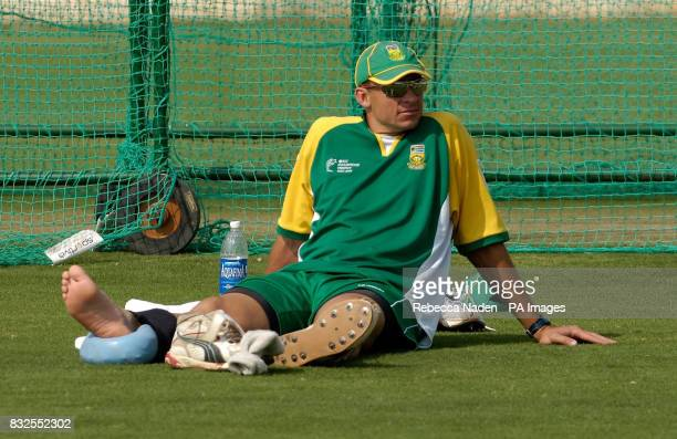 South African bowler Andre Nel rests his ankle on an ice pack during a training session at the Rajasthan Cricket Academy Jaipur India