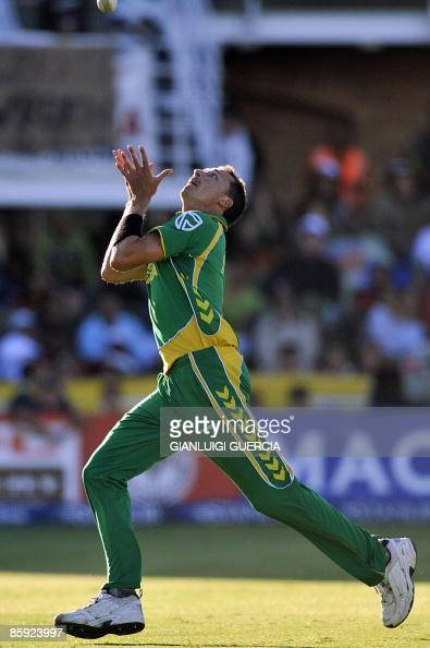 South African bowler Dale Steyn catches out Australian batsman Dave Hussey on April 13 2009 during the One Day International cricket match between...