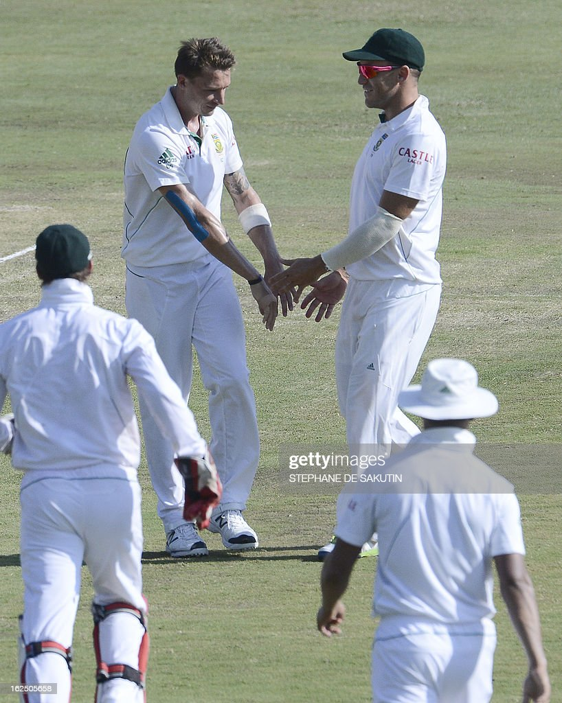 South African bowler Dale Steyn (L) is congratulated by teammates for the dismissal of Pakistan batsman Sarfraz Ahmed during the third day of the third Test match between South Africa and Pakistan on February 24, 2013 at Super Sport Park in Centurion.