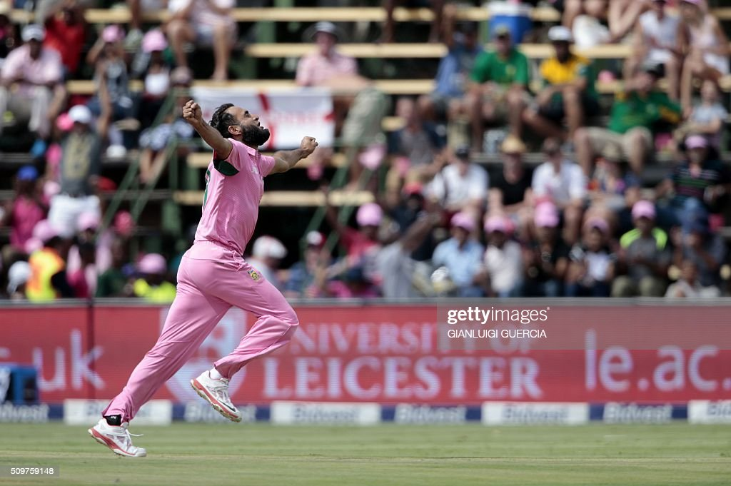 South African bowler Imran Tahir celebrates the dismissal of England's batsman Eoin Morgan (not in picture) during the fourth One Day International (ODI) cricket match between England and South Africa at Wanderers on February 12, 2016 in Johannesburg, South Africa. South African players are dressed in pink to raise awareness for breast cancer. / AFP / GIANLUIGI GUERCIA