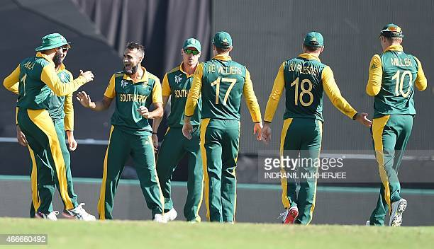 South African bowler Imran Tahir celebrates with teammates after taking athe wicket of Sri Lankan cricketer Mahela Jayawardene during the 2015...