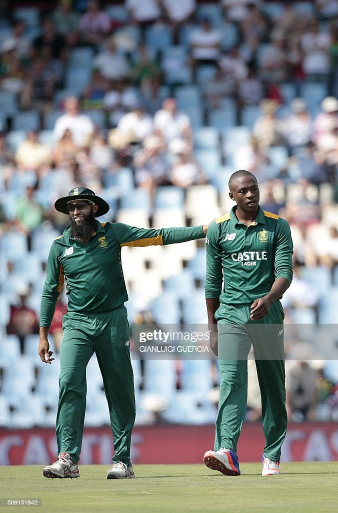 South African bowler Kagiso Rabada (R) and fielder Hashim Amla (L) celebrate the dismissal of England batsman Alex Hales (unseen) during the third One Day International (ODI) cricket match between England and South Africa at the Supersport park on February 9, 2016 in Centurion, South Africa. GUERCIA
