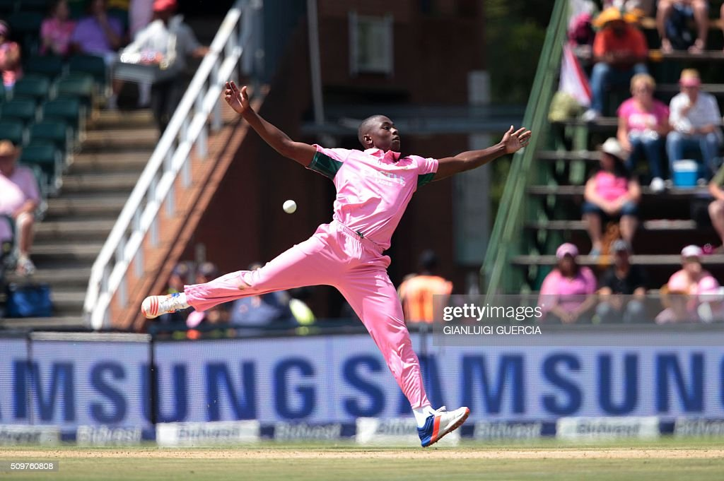 South African bowler Kagiso Rabada attempts to field on his own delivery during the fourth One Day International (ODI) cricket match between England and South Africa at Wanderers on February 12, 2016 in Johannesburg, South Africa. South African players are dressed in pink to raise awareness for breast cancer. / AFP / GIANLUIGI GUERCIA