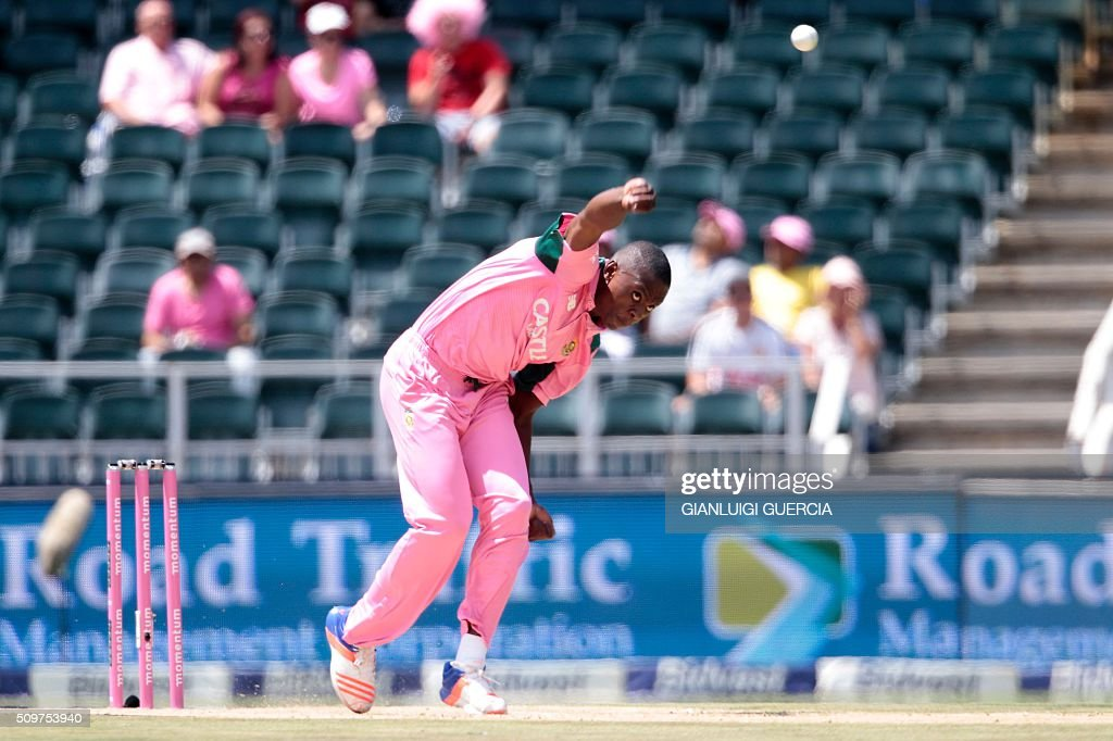 South African bowler Kagiso Rabada bowls on England's batsman Alex Hales (not in picture) during the fourth One Day International match between England and South Africa at Wanderers on February 12, 2016 in Johannesburg. South African player are dressed in pink to raise awareness for breast cancer. / AFP / GIANLUIGI GUERCIA