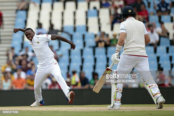 TOPSHOT South African bowler Kagiso Rabada celebrates the dismissal of England's batsman Joe Root during day 3 of the fourth Test match between...