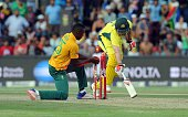 South African bowler Kagiso Rabada unsuccessfully attempts to runout Australian Mitchell Marsh during the T20 cricket match between South Africa and...