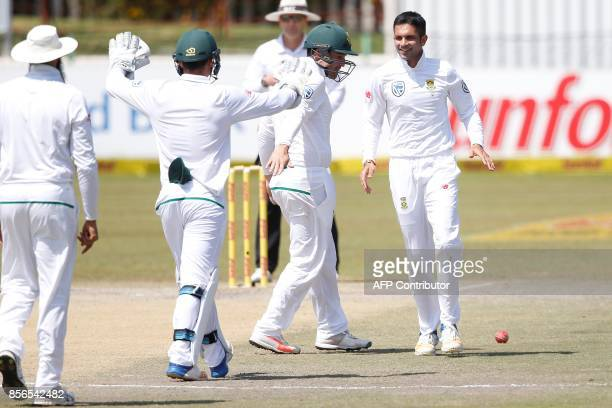 South African bowler Keshav Maharaj celebrates the dismissal of Bangladesh batsman Sabbir Rahman during the fifth day of the Test Match between South...