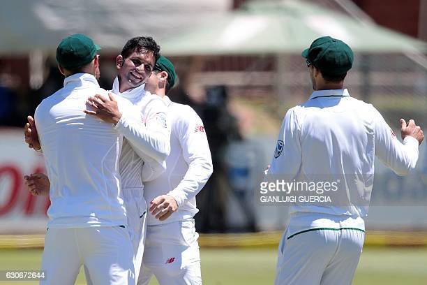 South African bowler Keshav Maharaj celebrates with his teammates after taking the last wicket of of Sri Lanka's batsman Nuwan Pradeep during the...