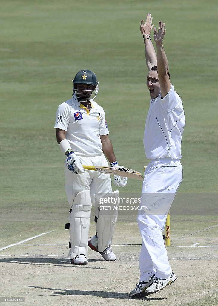 South African bowler Kile Abbott celebrates the dismissal of Pakistan's Imran Farhat (R) after being caught behind by wicketkeeper AB de Villiers during the third day of the third Test match between South Africa and Pakistan on February 24, 2013 at Super Sport Park in Centurion.
