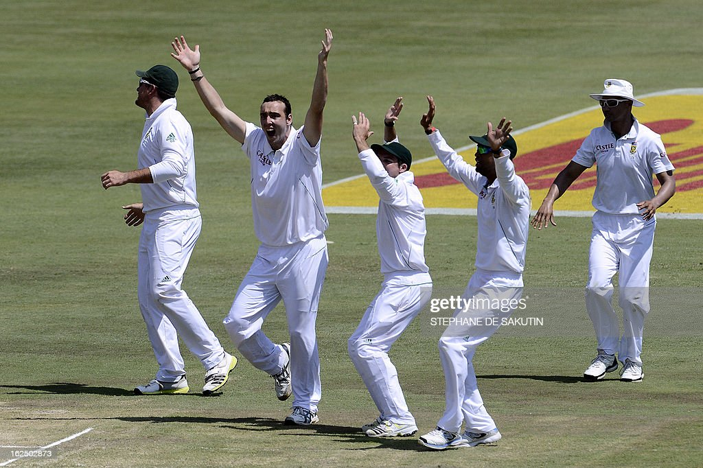South African bowler Kile Abbott (2ndL) celebrates with teammates the dismissal of Pakistan batsman Imran Farhat after being caught behind by wicketkeeper AB de Villiers during the third day of the third Test match between South Africa and Pakistan on February 24, 2013 at Super Sport Park in Centurion.