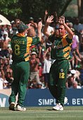 South African bowler Nicky Boje is congratulated 09 January 2001 by teammate Jonyt Rhodes after taking the wicket of Sri Lankan batsman Sanath...