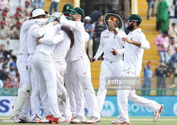 South African bowler Rabada celebrates after taking the wicket of Indian batsman Virat Kohli during the first test match at PCA Stadium on November 5...