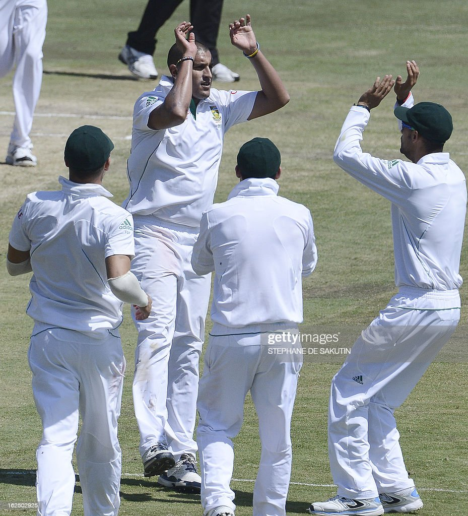 South African bowler Rory kleinveldt is congratulated by teammates for the dismissal of Pakistan batsman Asad Shafiq during the third day of the third Test match between South Africa and Pakistan on February 24, 2013 at Super Sport Park in Centurion.