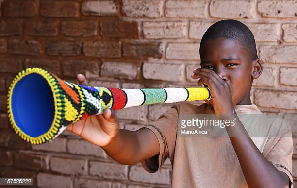 South African boy blowing Vuvuzela