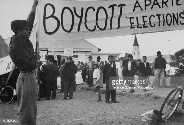 South African boy displaying banner to boycott the elections