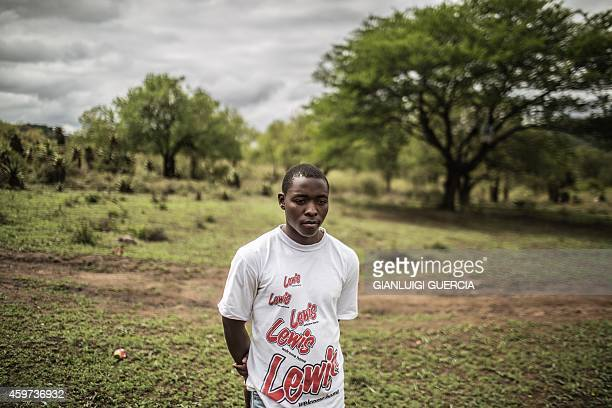 A South African boy from a rural area in the KwaZulu Natal province waits on the road to be picked up by health workers working with Doctors Without...