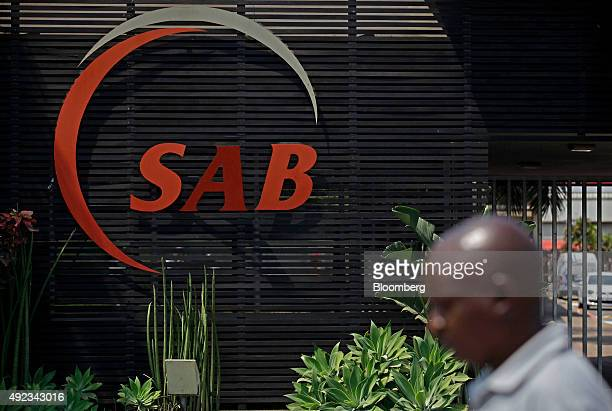 A South African Breweries logo sits on display outside the Prospecton brewery a unit of SABMiller Plc in Durban South Africa on Monday Oct 12 2015...