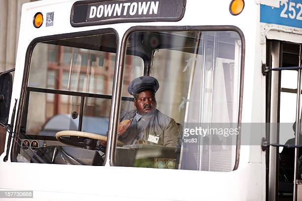 South African busdriver on white downtown bus