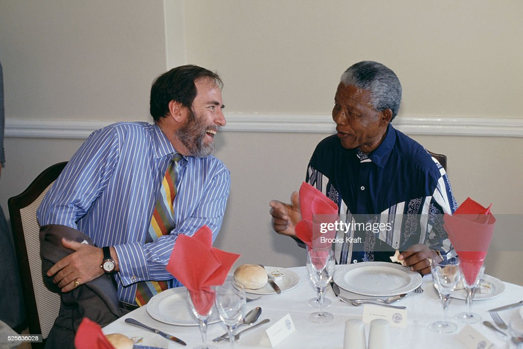 South African businessman and chairman of the De Beers diamond mining company Nicky Oppenheimer and antiapartheid activist Nelson Mandela leader of...