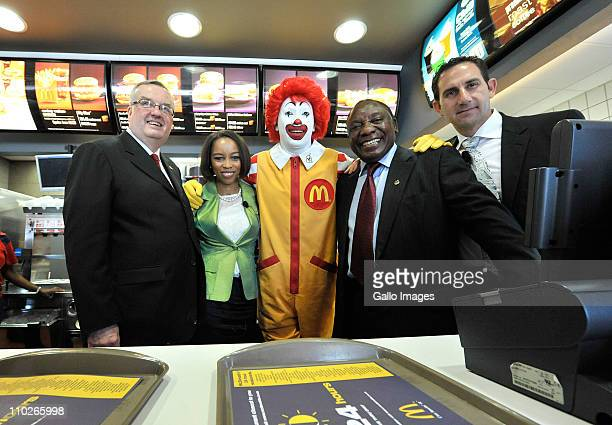 South African businessman Cyril Ramaphosa poses with Mcdonalds' president David Murphy McDonalds' staff and Ronald McDonald the clown at a McDonalds'...