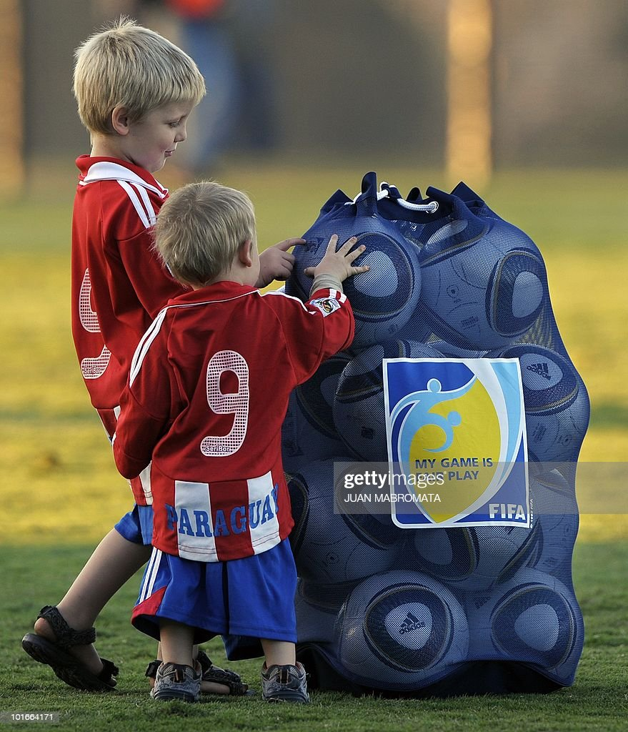 South African Caleb (L) and his brother Ben, born in Asuncion in Paraguay, check a bag of balls belonging to the Paraguay squad at the end of their training session at Harry Gwala stadium in Pietermaritzburg on June 6, 2010 ahead of the 2010 World Cup in South Africa.