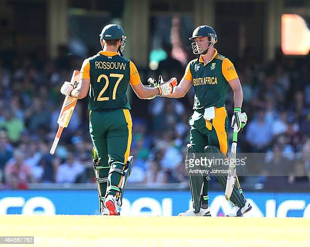 South African captain AB De Villiers shakes the hand of Rilee Rossouw after he was dismissed by Jerome Taylor during the 2015 ICC Cricket World Cup...