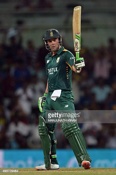 South African captain and batsman AB de Villiers raises his bat after scoring 50 runs during the one day international cricket match between India...