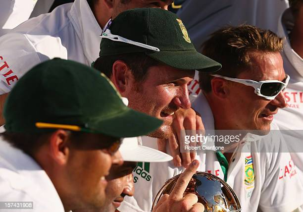 South African captain Graeme Smith celebrates with his team after South Africa defeated Australia on day four of the Third Test Match between...