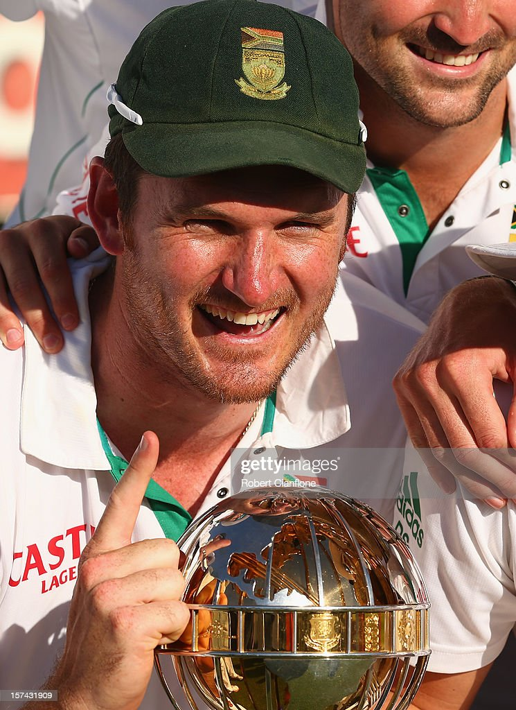 South African captain <a gi-track='captionPersonalityLinkClicked' href=/galleries/search?phrase=Graeme+Smith+-+Cricket+Player&family=editorial&specificpeople=193816 ng-click='$event.stopPropagation()'>Graeme Smith</a> celebrates with his team after South Africa defeated Australia on day four of the Third Test Match between Australia and South Africa at WACA on December 3, 2012 in Perth, Australia.