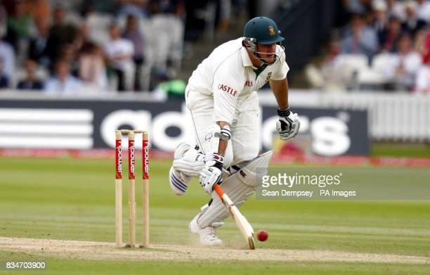 South African captain Graeme Smith runs in safe during The First npower Test match at Lord's Cricket Ground London