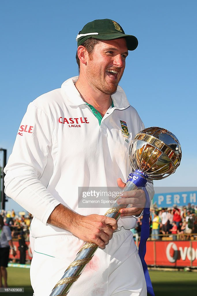 South African captain <a gi-track='captionPersonalityLinkClicked' href=/galleries/search?phrase=Graeme+Smith+-+Cricket+Player&family=editorial&specificpeople=193816 ng-click='$event.stopPropagation()'>Graeme Smith</a> walks off the field with the ICC Test Championship mace after winning the series during day four of the Third Test Match between Australia and South Africa at the WACA on December 3, 2012 in Perth, Australia.