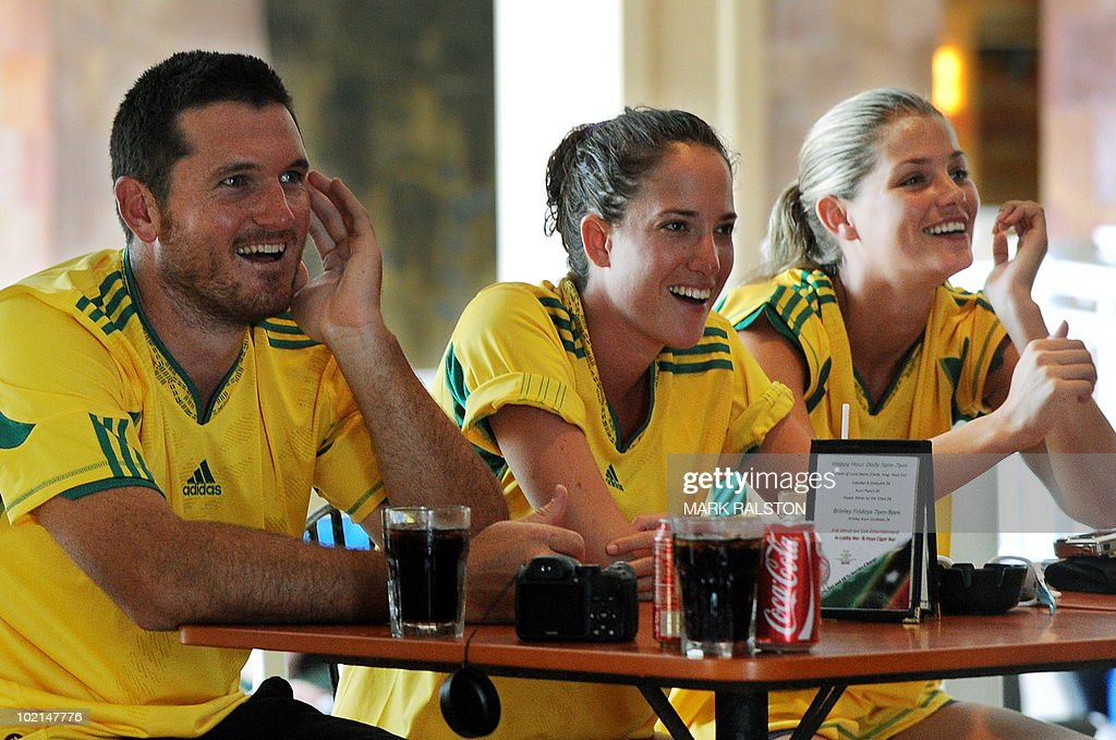 South African captain Graeme Smith (L) watches the South Africa versus Uruguay World Cup football match with family members as they relax before the second test at the Warner Park ground in the St Kitts capital of Basseterre on June 16, 2010. South Africa have taken a 1-0 lead in the three-Test series, with the second test beginning on June 18. AFP PHOTO/Mark RALSTON