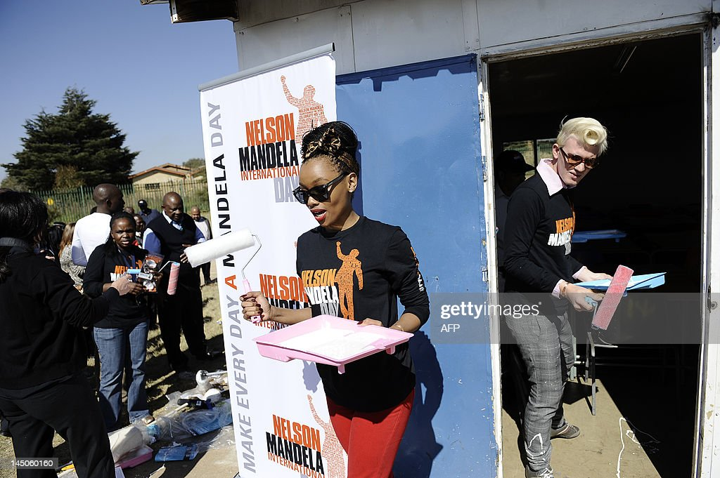 South African celebrities get ready to paint two classrooms on May 23, 2012 at Thlatlogang junior secondary school in Soweto to set the tone before the Mandela's 94th birthday and Mandela Day on July 18, 2012. For the fourth year, at the request of his charitable foundation, July 18 will be observed as Mandela Day, recognised by the United Nations as a global call to volunteer for good causes for 67 minutes -- representing each year of Mandela's life in active politics. AFP PHOTO/ STEPHANE DE SAKUTIN