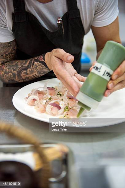 South African chef Timothy Bruyns preparing a salad of raw tuna and banana stem in the kitchen of his Phnom Penh restaurant the Common Tiger Bruyns...