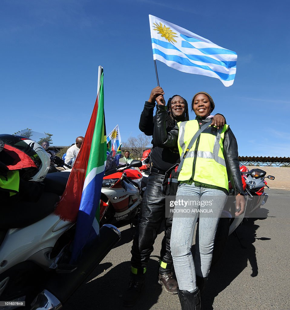 South African citizens in motorcycles prepare to welcome the Uruguayan national football team in Kimberley, on June 5, 2010. The South Africa 2010 World Cup starts on June 11. AFP PHOTO/ Rodrigo ARANGUA