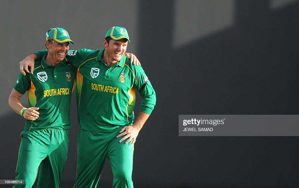 South African cricket team captain Graeme Smith and his teammate Johan Botha celebrate their victory at the end of the second One Day International match between West Indies and South Africa at the Sir Vivian Richards Stadium in St John's on May 24, 2010. South Africa defeated West Indies by 17-runs. AFP PHOTO/Jewel Samad