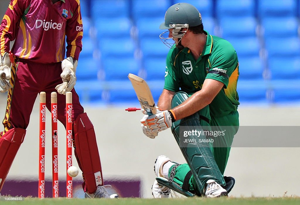 South African cricket team captain Graeme Smith (R) is clean bowled off West Indies bowler Nikita Miller during the second One Day International match between West Indies and South Africa at the Sir Vivian Richards Stadium in St John's on May 24, 2010. AFP PHOTO/Jewel Samad