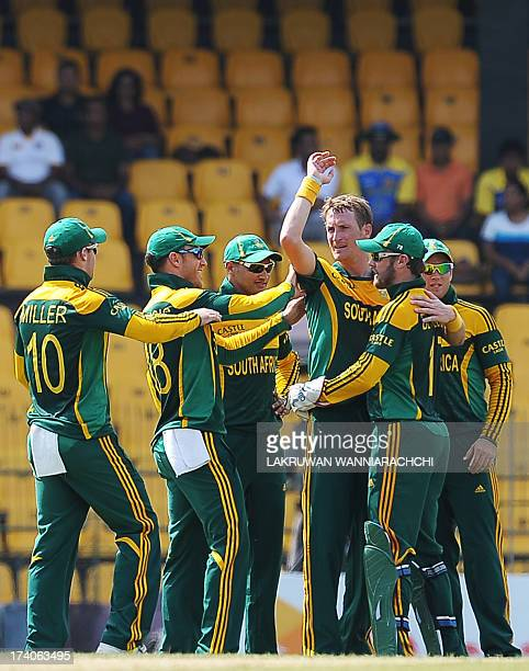 South African cricketer Chris Morris celebrates with his teammates after he dismissed Sri Lankan batsman Tillakaratne Dilshan during the first One...