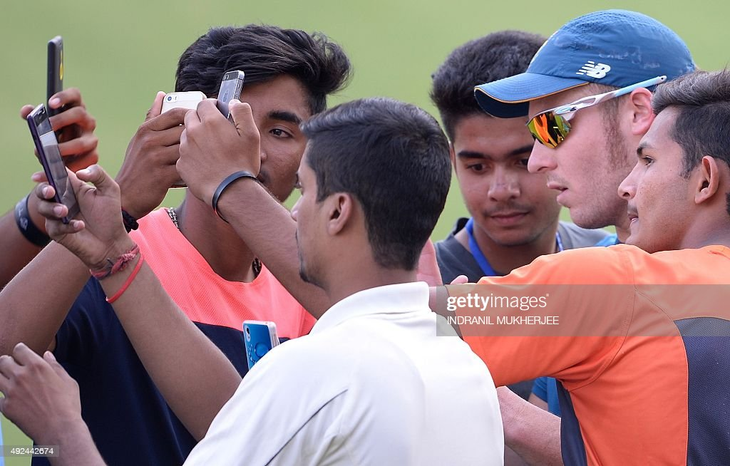 South African cricketer <a gi-track='captionPersonalityLinkClicked' href=/galleries/search?phrase=David+Miller+-+Cricket+Player&family=editorial&specificpeople=15061693 ng-click='$event.stopPropagation()'>David Miller</a> (2R) is mobbed by net bowlers for a selfie during training on the eve of the second one day international (ODI) cricket match between India and South Africa at The Holkar Cricket Stadium at Indore on October 14, 2015.